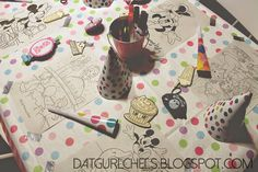 DatgurlChels: We have a ONE year old!  This was the table at my daughter's first birthday party. Children could color, or play games. I used washi tape and various coloring pages as my placemats. Tin cans from Target's $1 bins to hold crayons/ markers. there were party hats and noise makers as party favors.
