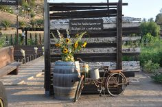 Rustic barrel, divider and bicycle used for wedding decoration complete with your ideal wedding quote. #Peltzerwineryandfarm, #peltzerwedding, #temeculawedding