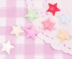 Cute and colourful small stars in an array of colours! These flat back cabochons are made from clear resin with gorgeous pearlised star sequins in the middle. #Clothing #Craft
