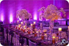 reception room tablescape, purple up lighting, candle light, white flowers