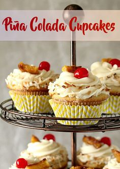 Piña Colada Cupcakes are Rum-Kissed Heaven! Did we mention the boozy buttercream frosting?