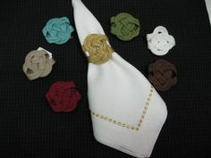 Left: Top to Bottom Aqua Frog, Beige Frog and Burgundy Frog Middle:Gold Frog Right: Top to Bottom Green Frog, White Frog and Brown Frog Napkin: White with Embroidered Gold Metallic Beads