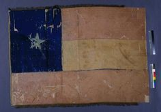 This flag was created for the 5th Texas Infantry Regiment in Richmond, Virginia, shortly after the unit was activated from 10 companies of men who had traveled east to join the conflict. It is based upon the design of the Confederate national flag (known as the Stars and Bars), but modified to feature the Lone Star of Texas. The 5th Texas Infantry Regiment became part of Hood's Texas Brigade, named for its commander, General John Bell Hood. In the summer of 1862, Hood's Brigade played a…