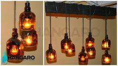 Diseño de lámpara con base antigua de madera y botellas de whisky. #Hangaro #Guatemala #CreacionChapina #Vidrio