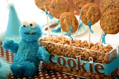 Cool idea to use cereal to hold cookie pops....Cookie Monster Party #cookiemonster #party