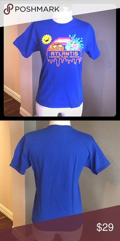 "Fun Amazing World of Gumball T-Shirt Great for collectors of funky t-shirts. From Atlantis in Paradise Island, Bahamas. 100% Cotton. Tag says Youth Large, but as you can see in the pics, it makes a great fitted woman's t-shirt and fits Woman's Small/Medium. Worn once as a cute fitted woman's T. Please make sure approximate measurements below work for you.   Approximate Measurements (unstretched):  Bust- 33"" Shoulder width- 16"" Length- 21""  Approximate Measurements of Dress form for…"