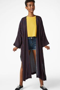 A flowy kaftan dress with 3/4 length sleeves and long slits on the sides, striped to perfection. Let's bring out that inner flow!