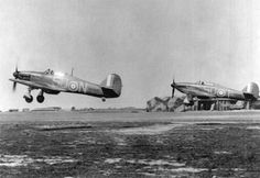 This is a famous shot taken at RAF Hawkinge during the Battle of Britain. Navy Aircraft, Ww2 Aircraft, Air Fighter, Fighter Jets, Hawker Hurricane, Supermarine Spitfire, Ww2 Planes, Battle Of Britain, Royal Air Force