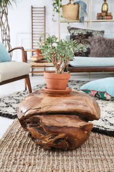 A teak Root ball makes a killer side table, and we love it featured in the Libra #PatinaZodiacStyle project! Its a nice woodsy earthy touch to their peaceful nature. | Patina