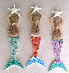 Create your own mermaid!! Just convo me with all the details including hair color, beads or shells and the colors you would like. Also let me know the tail color. I have glass beads in many different colors and I also use broken shells in three different colors including natural, blue and lavender. I can do the hair in blonde, gray, white, black, auburn and light or dark brown. This lovely Mermaid wall hanging is carved from wood, then painted and decorated with glass beads, tiles, real…