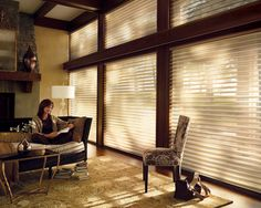 Add a warm casual elegance to your living room with the Bronze Shimmer sheer and the Signature S-Vane™ that tilts for ultimate light control––Alustra® Silhouette® window shadings ♦ Hunter Douglas window treatments