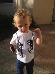 Ollie looking adorable in our Young and Moodie football tee