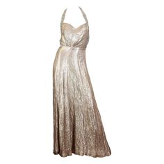 Spectacular Backless 1930s Silver Lamé Gown   From a collection of rare vintage evening dresses at https://www.1stdibs.com/fashion/clothing/evening-dresses/