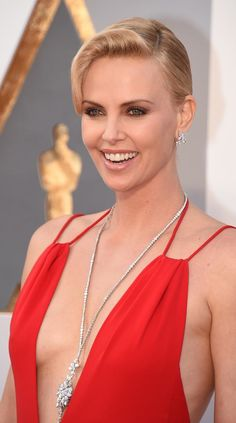 Charlize Theron arrives at the 88th Academy Awards in $3.7 million worth of Harry Winston Diamonds including the Secret Cluster Diamond Necklace, 48.8 carats, the Winston Cluster Diamond Earrings, 15.49 carats, Cushion-Cut Diamond Ring with Micropave, 8.78 carats, Micropave Diamond Band Ring, and Queen Diamond Ring, 7.44 carats, all set in platinum.   Some seriously notable Oscars jewelry on Charlize. (Photo by Jordan Strauss/Invision/AP)