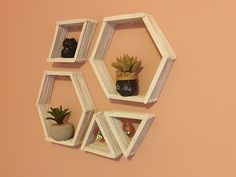 Super easy DIY geometric wall shelves!  https://teenagegrandmablog.wordpress.com/2016/07/15/diy-geometric-wall-shelves/
