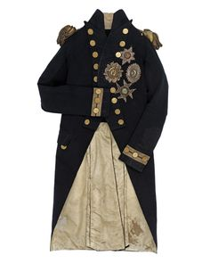 The vice-admiral's undress uniform coat Horatio Nelson (1758-1805) was wearing when he was fatally shot by a sniper on the deck of HMS Victory on 21 October 1805. There is a bullet hole on the left shoulder, close to the epaulette. Blood stains on tails and left sleeve, are probably those of Nelson's secretary, John Scott, killed earlier in the action. National Maritime Museum.