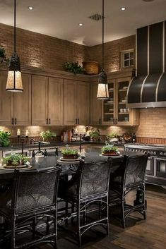 Incredibly detailed kitchen design.  I'm usually not so big on darker kitchens, but this one is very nicely planned out and designed.