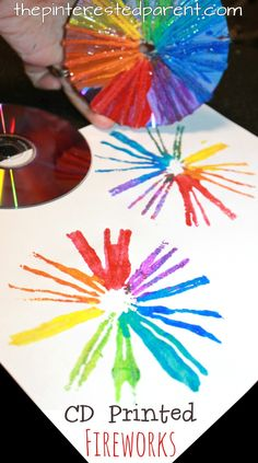 Cd printed fireworks for the 4th of July. Cd printmaking techniques using paint , yarn, Q-tips and paint. Arts and craft ideas for preschoolers and kids.