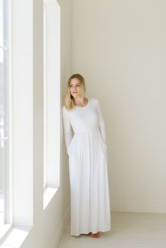 Jayne - Temple Dress Maternity friendly 95% Rayon 5% Spandex Model is 5'7 and wearing a size Medium Dress has pockets Dry-clean or gentle machine wash Do not t