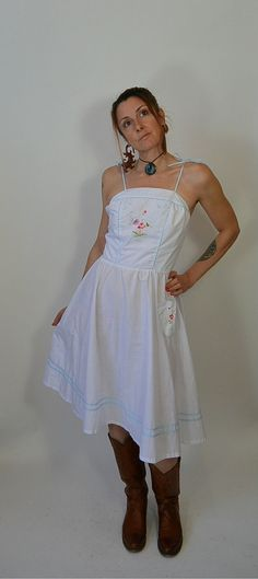 SALE DRESS  was $58 now only $38  This is an amazing dress, looks great on everyone. It has a flower embroidered on the front and pocket and baby blue piping. Perfect for a hot summer day. all measurements taken while garment is laying flat.  armpit to armpit 19 inches (38 inches around)  waist has elastic waistband stretched it is 18 inches (36 around) un-stretched 14 (28 around)  nape to hem 42 inches  could be worn by a small or medium (I have a small chest so it was a little big for me…