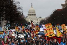 Protesters march during a demonstration against the Dakota Access Pipeline on March 10, 2017 in Washington, DC. Thousands of protesters and members of Native nations marched in Washington DC to oppose the construction of the proposed 1,172 Dakota Access Pipeline that runs within a half-mile of the Standing Rock Sioux reservation in North Dakota. (Justin Sullivan/Getty Images)