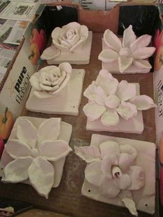 "ceramic flower sculptures; approx. 7"" X 7""; lesson by art teacher"