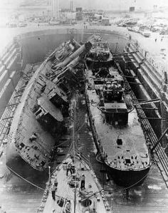 USS Cassin (DD-372), at left, and USS Downes (DD-375) Under salvage in Drydock Number One at the Pearl Harbor Navy Yard, 23 January 1942.They salvaged much of the machinery (especially the main turbines and reduction gears), shipped it to Mare Island, and built new ships on a modified Mahan-class design, reusing the original hull numbers.