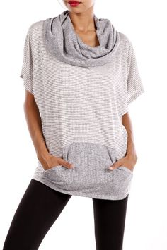 Cowl neck top with front pockets. - 44% Cotton, 44% Rayon, 12% Polyester