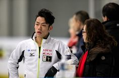 Daisuke Takahashi of Japan talks to his coach Utako Nagamitsu during practice at Budweiser Gardens in preparation for the 2013 World Figure Skating Championships in London, Ontario, Canada, March 11, 2013. Skaters from around the globe are preparing for the competition which starts on Wednesday.