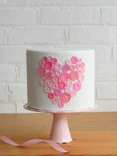A sweet Valentine's cake with fondant buttons.