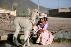 Young Girl and Her Baby Alapaca, Peru