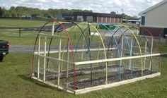 Chicken hoophouse from pvc | The kids then planted the beds with pumpkins, squash, and sunflowers ...