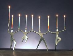 Line Dancing Menorah: Boris Kramer: Metal Menorah | Artful Home