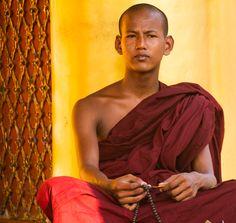 monk with prayer beads, Shwedagon Pagoda, Yangon, Myanmar