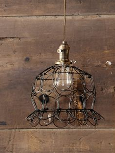 A wire farm basket inspired this pendant lamp by Philadelphia's Peddlers Home Design.