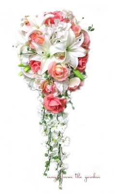 This cascade bouquet of coral Real Touch roses, Real Touch white Asiatic lilies, white silk hydrangea, and silk white larkspur create a lovely bridal bouquet that can be yours to have and to hold on y