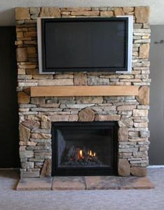 Gas Stone Fireplace gas fireplace with stacked stone, pieced hearth, corbels, board