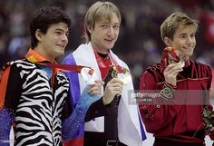 Gold medalist Russia's Yevgeny Plushenko (C), silver medalist Stephane Lambiel of Switzerland (L) and bronze medalist Jeffrey Buttle of Canada pose with their medals after the podium of the men's figure skating at the 2006 Winter Olympics, 16 February 2006 at the Palavela in Turin.