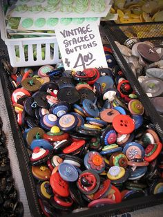 ButtonArtMuseum.com - A basket of buttons at the Brimfield Fair in Brimfield, MA.