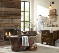 Warm bathroom, fireplace next to free-standing tub