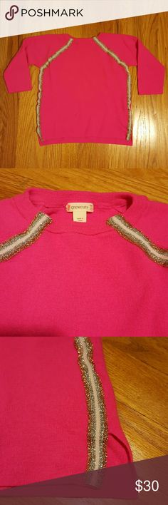Crewcuts Girls Neon Pink Merino Wool Sweater 10 Adorable bright neon pink girls sweater by Crewcuts (J.Crew for kids).  Size girls 10, could also fit an 8. Sweater features glittery trim, side vents, allover fine rib knit fabric. Like new except flaw in last picture (small pinhole).  100% high quality merino wool is super soft.  She is sure to stand out in this eye-catching and fun sweater! Crewcuts Shirts & Tops Sweaters