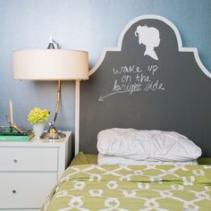 Great headboard idea for a girls room...It's simple to build but you may need certain special materials like the chalkboard paint. The item consists of a wood cutout, painted with the  chalkboard paint, a dustless chalk to write and draw everyday  whatever you think is important, and a nice vintage silhouette. {found on The Inglenook Decor}.