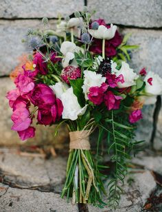 bougainvillea bouquet with thistle, anemones and cosmos