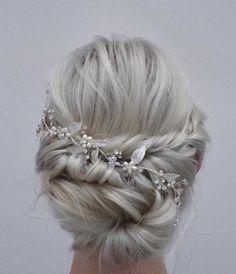 Pretty twisted bridal updo by Renèe Marie