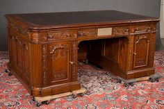 Lot 241: Custom made reproduction of the famous mahogany Resolute executive desk, a copy of the original desk which is in the oval office of the President of the United States, the original desk was made as a gift from Queen Victoria to President Rutherford