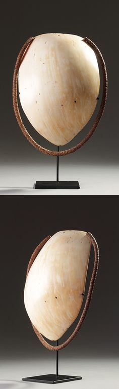 Papua New Guinea - Kiwai | Man's pubic shield / cover ~ Yadere-ere ~ shell and fiber.  H:  26.5 cm without the stand || POR