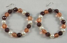 These gorgeous circular earrings are made from a mix of brown beads. They measure at 5 cm.