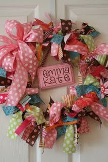 Ribbon Wreath ....Tie bows from colorful ribbon onto a wire wreath, hang a name plate from the top center, and hang on the outside of your daughter's bedroom. So cute.