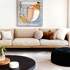 mark_tuckey sofa, floor cushion by  rachel castle and things. Painting by Moi. Photo by  ameliastanwix