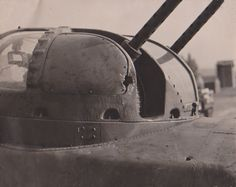 """Photo History - 91st Bomb Group (H) Lt. Jewett wrote, """"A 20mm cannon shell entered the top turret, hit the armor plate on back of my seat and exploded, knocking out the left side window and puncturing my eardrum, showering plexi-glass all over. Only me and the laundress know how close this one came."""""""